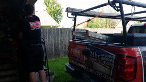 aladdin garage door service company truck at job site