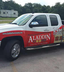 service truck of Aladdin garage Doors of Houston Texas