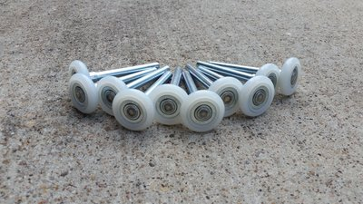 nylon garage door rollers are superior and quieter than metal or rubber rollers & Easy Tips for How to Make Your Garage Door Quieter pezcame.com